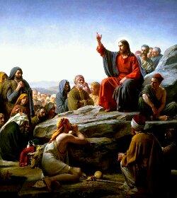 A faith healer preaching enemy love