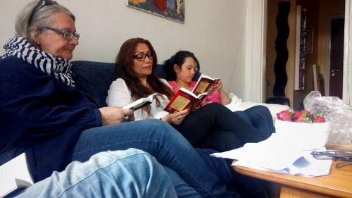 My pastor Lotta (left) reads the Bible with some new visitors at a Sunday meeting in our house church Mosaik